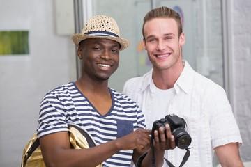 Portrait of photo editors with camera