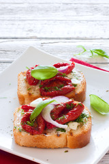 Toasts with tomatoes, basil and onions