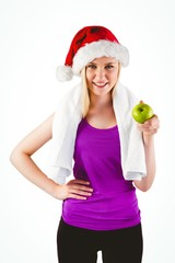 Festive fit blonde smiling at camera holding apple