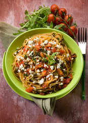 spaghetti with tomatoes cheese capers and arugula
