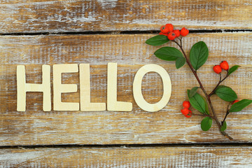 """Hello"" written with wooden letters on rustic wooden surface"