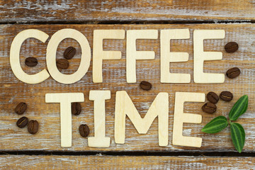 Coffee time written with wooden letters on rustic wood