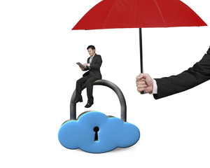 umbrella protect businessman using tablet on cloud lock