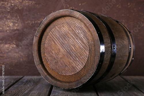 Leinwandbild Motiv Barrel on wooden table on wooden wall background
