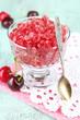Closeup of cherry granita in glass bowl,