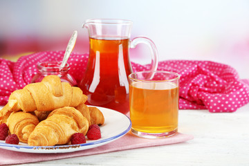 Breakfast with apple juice, jam and fresh croissants