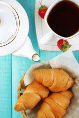 Breakfast with tea and fresh croissants