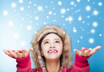 happy young woman watching snow