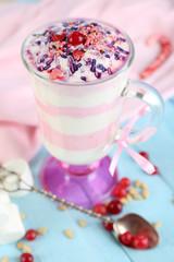 Cranberry milk dessert in glass,