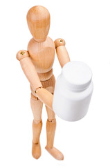 Wooden man hold a medical container with vitamins
