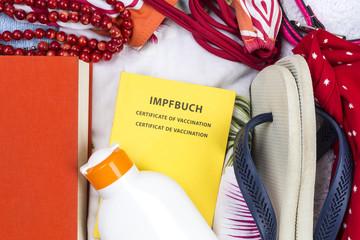 Reisegepäck mit Impfbuch, Freiburg, Deutschland