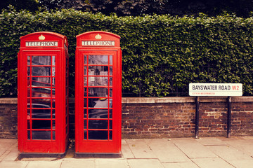 art row of traditional phone boxes in London city