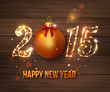 Happy New Year 2015 celebration concept on wooden background.