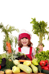 happy little girl with carrots and vegetables