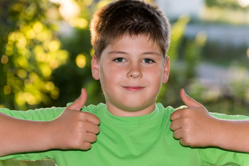 The boy shows gesture that all is well