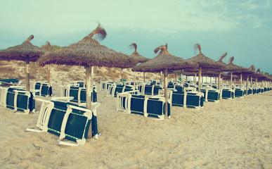 Plenty of sun loungers on the beach. Vintage effect.