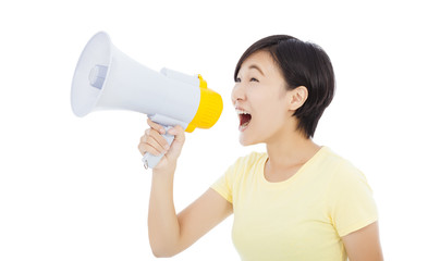 young student girl standing and holding megaphone. isolated on w