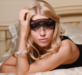 The beautiful blonde girl on a bed