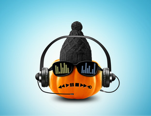 Music pumpkin in the headphones and sunglasses