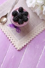 Healthy breakfast - yogurt with  blackberries and muesli served