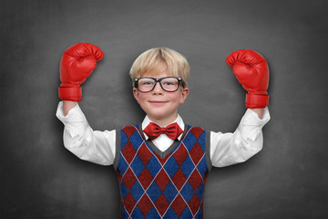 Child with muscle / boxing gloves