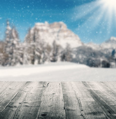 Winter scenery with wooden planks