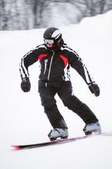 Teen snowboarder in black costume