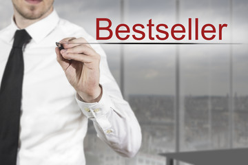 businessman writing bestseller in the air