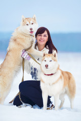 Young woman with siberian husky
