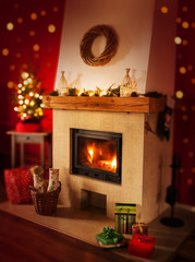 Fireplace with gifts, christmas tree - home interior decoration