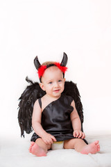 beautiful little boy dressed as a demon. valentine's day concept
