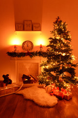 Christmas tree near fireplace in room