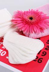 Sanitary pads, calendar, towel and pink flower