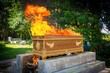 Leinwanddruck Bild - fire on the coffin for cremation