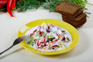 Plate of salad with black bread and spices