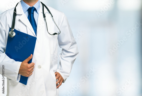 Doctor holding a clipboard - 71887369