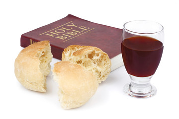 Bible, bread and wine isolated on white background