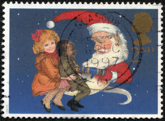 Santa as Man in Moon Sharing Cracker with Two Children