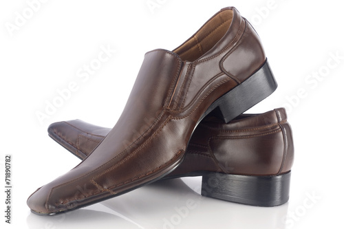 canvas print picture Two brown shoes isolated on white background