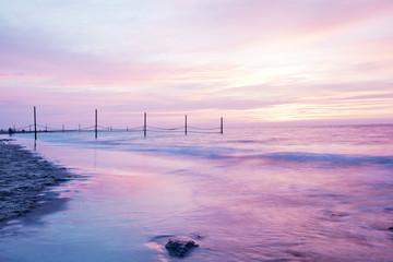 Beautiful rose sunset at a coast