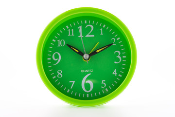 Green clock isolated on white background