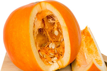 Ripe cut the pumpkin on a white background.