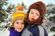 Cute children in winter forest