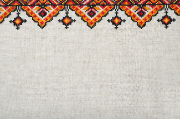 multicolored embroidered element on linen cotton threads