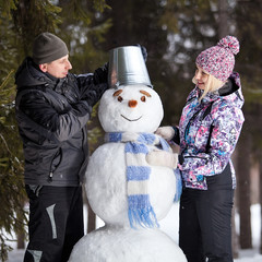 Couple makes snowman