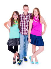 Teen boy standing with two girlfriends