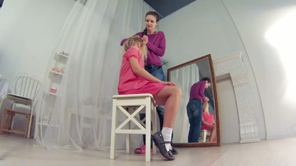 Young girl hairdressing, time lapse