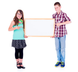 Boy and girl pointing on empty board