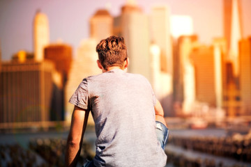 Young man is looking at Manhattan