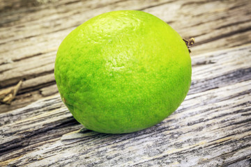 Citrus lime fruit on a wooden boards